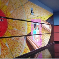 """""""Festivals of Mexico and South America"""" Indoor mural 90 x 15 ft. created with Yollocalli Arts Reach students. Mural is  located at Nettlehorst Elementary School"""