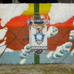 """Spirituality and Surveillance"" (Front) Outdoor mural 40 x 10 ft. commissioned by Immodest Proposals Version 2009, Chicago, IL. Destroyed by Graffiti blasters by orders of 11th ward Alderman Balcer in the Community of Bridgeport, 2009"